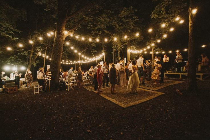 diy backyard wedding in the woods, reception, string lights, rug dance floor. Kansas City, Missouri | Mary + Dillon | Aaron & Whitney Photography