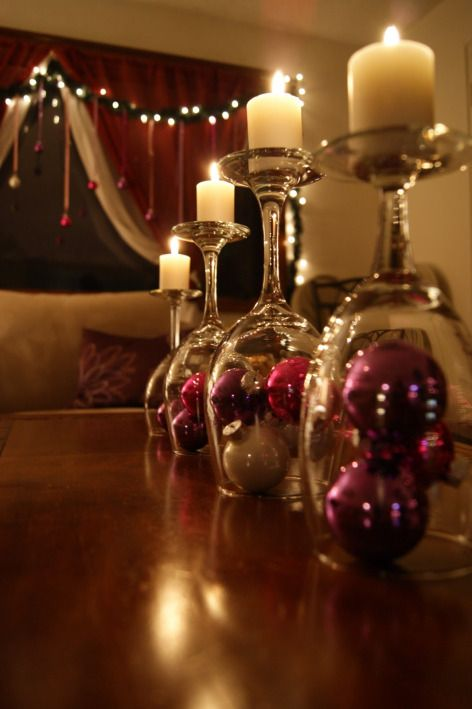 Turn a wine glass upside down and use it as a candle holder then decorate with ornaments - beautiful!!