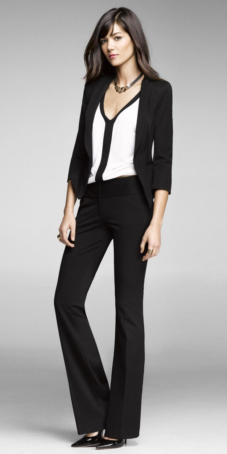 Another simple black and white outfit: black blazer and pants, white blouse with black trim. The neck is too low for me, but I like this look a lot.