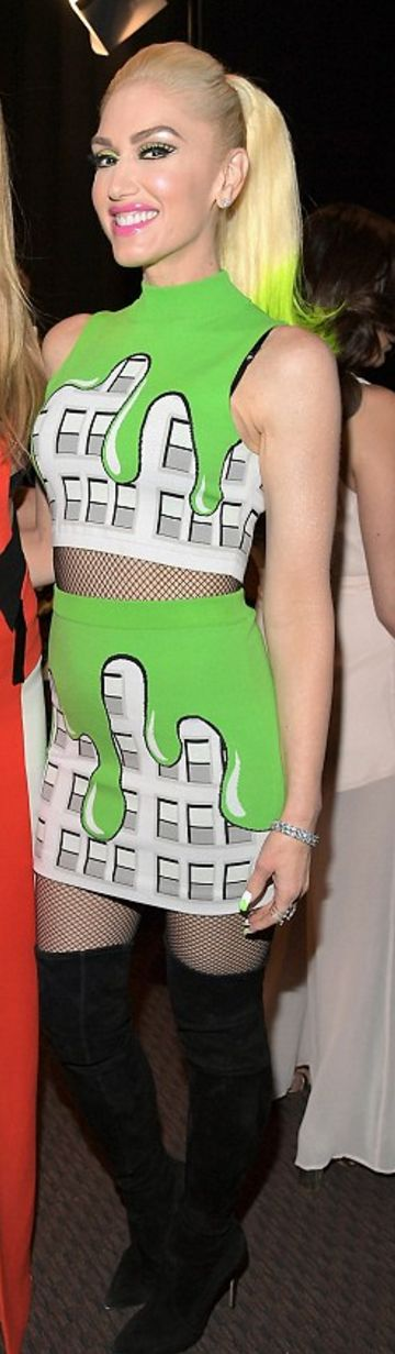 Who made Gwen Stefani's green print skirt, crop top, and black suede thigh boots?