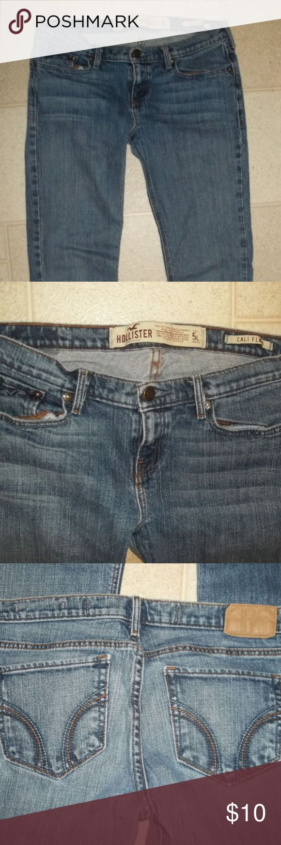 Hollister Cali Flare Jeans size 5 L stretch Very good condition! Tiny hole on calf. Wearing thin above cuff.  Waist: 30 Hips: 34 Rise: 7 1/2 Inseam: 29 Hollister Jeans Flare & Wide Leg