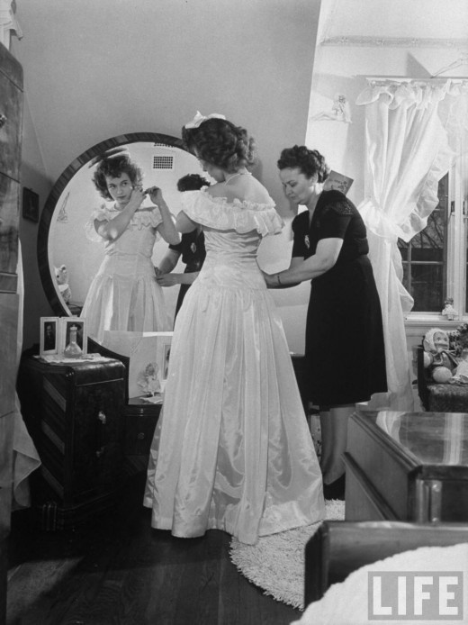 Girl getting ready for the Southwest High School Kansas City ROTC Ball, LIFE magazine, 1945. Photo by Myron Davis.