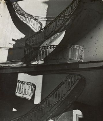 Bill Brandt. Bombed Regency Staircase, Upper Brook Street, Mayfair./i c. 1942. Gelatin silver print. Acquired through the generosity of Clarissa A. Bronfman