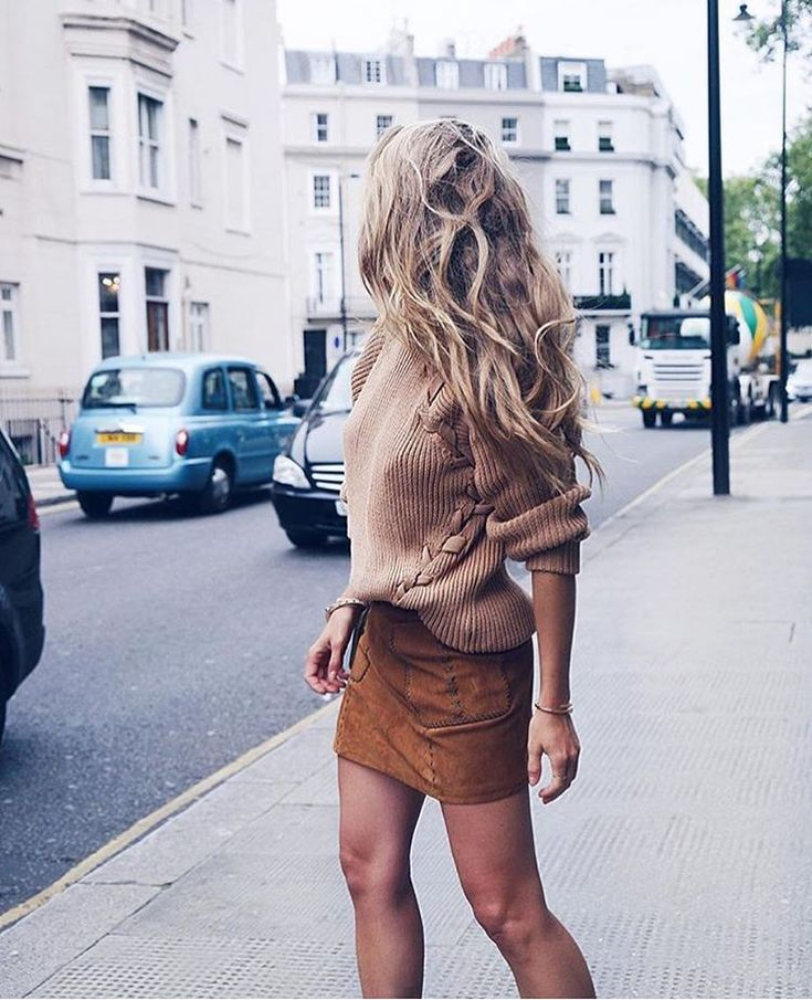 Brown suede skirt and tan sweater.