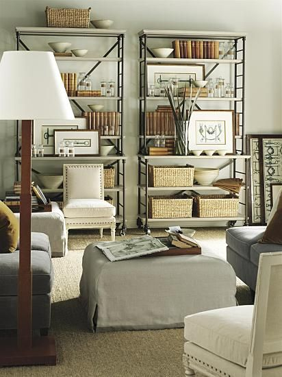 Your etegeres flanking the fireplace in living room, include artwork, books and pottery collection