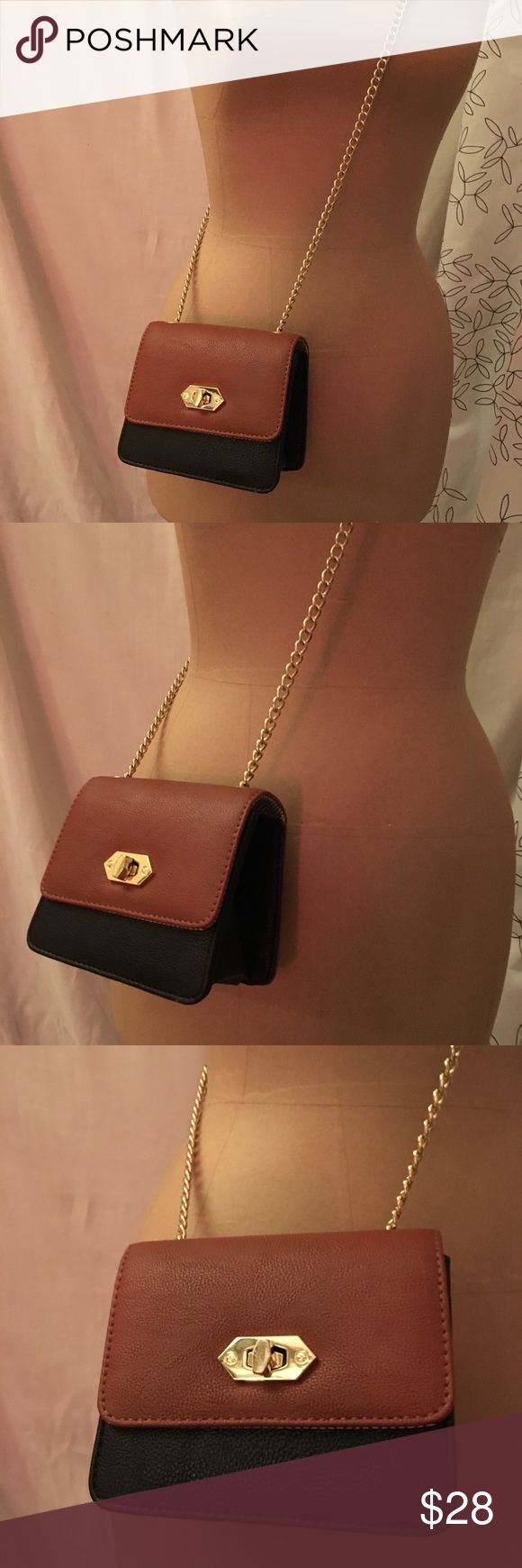 Small Steve Madden purse Small brown/black Steve Madden purse with cold chain as strap. Steve Madden Bags Crossbody Bags