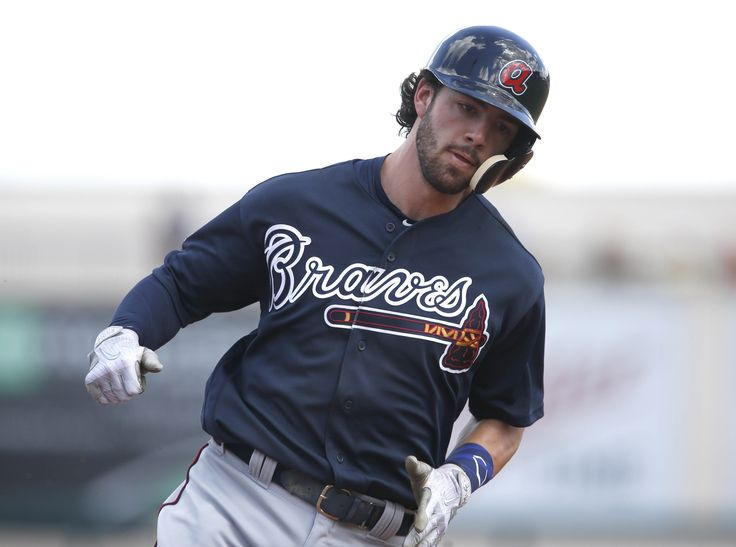Feb 27, 2017; Lakeland, FL, USA; Atlanta Braves outfielder Dansby Swanson rounds third base to score during the first inning of a baseball game against the Detroit Tigers at Joker Marchant Stadium. Mandatory Credit: Reinhold Matay-USA TODAY Sports