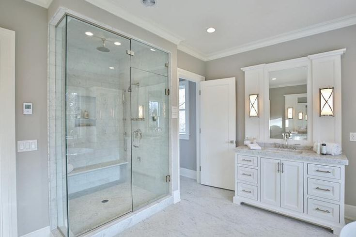 Wall Sconces Next To Mirror : Chic bathroom features a white glam vanity topped with light gray marble under a mirror ...