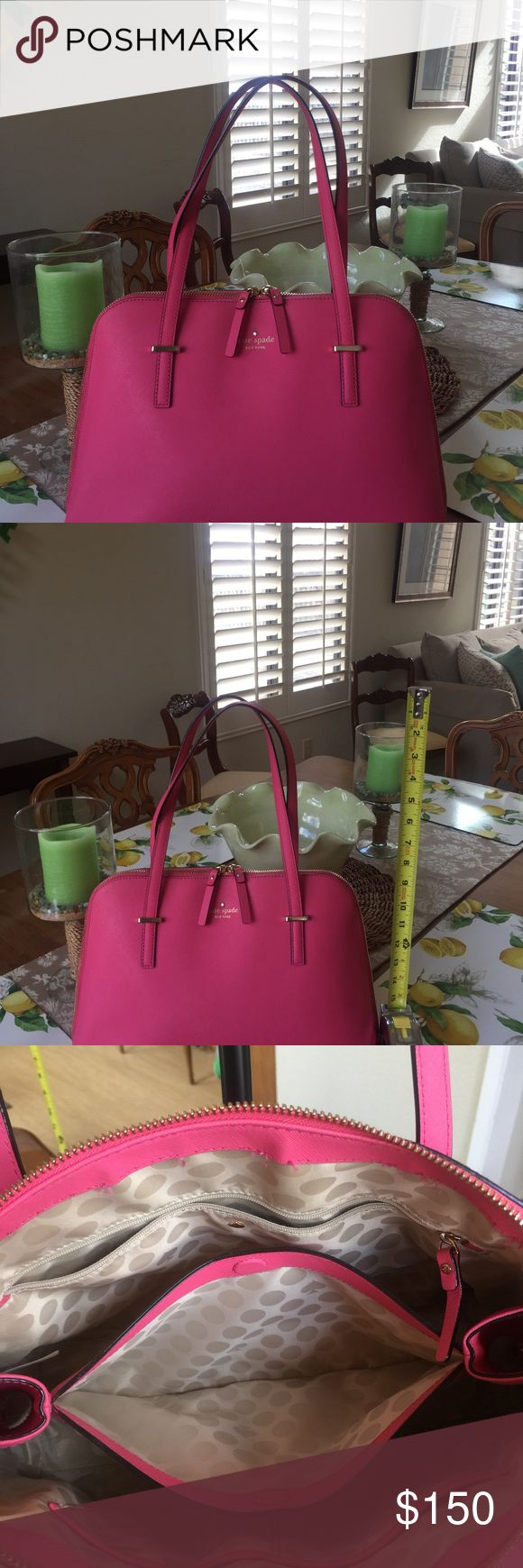 Kate Spade Medium Handbag This gorgeous hot pink bag holds your iPhone 7, MacBook, etc. The exterior is in great shape (minor mark as pictured) and the interior is nearly flawless! No marks. I included a picture of some loose stitching on the inside near the top zipper. This doesn't impact the great performance of this piece. This bag will get you noticed! Great for work, play, and shopping! kate spade Bags Shoulder Bags