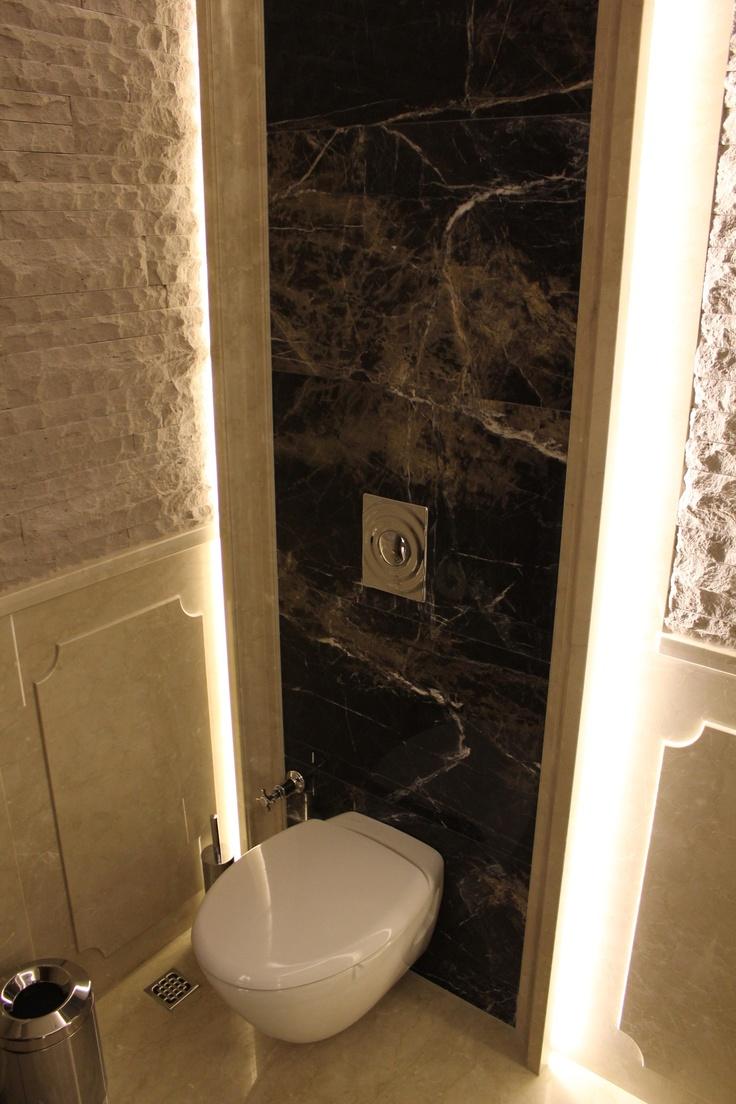 Guest toilet - lighting behind back panel