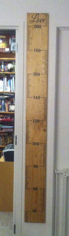 The kids growth chart. I wanted to be able to shift it with us if we ever move.  The kids can't get any taller than 209 cms... that's really tall so with our genes we should be safe ;-)