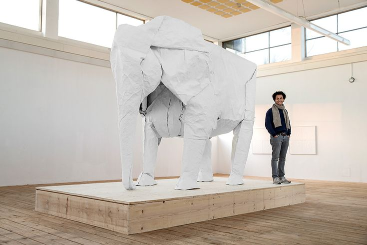Photo by Philipp Schmidli  Following a successful campaign on Indiegogo which raised nearly $26,000, artist Sipho Mabona followed through on his promise to fold a life-sized elephant from a single giant sheet of paper