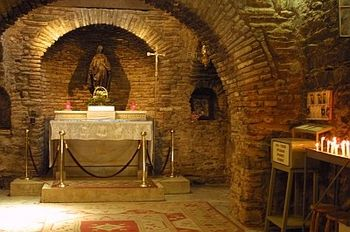 Interior of the House of the Virgin. The house of the Virgin is located in a nature park between Ephesus and Seljuk, is believed to be the last residence of the Blessed Mother.  Mary was brought to Ephesus by the Apostle John after the Resurrection of Christ and lived out most of her days in Ephesus.