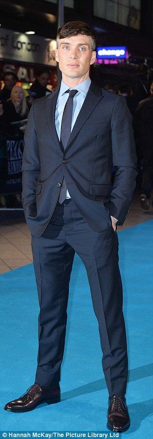 Suited and booted! Cillian Murphy looked smart as he stepped out on the blue carpet