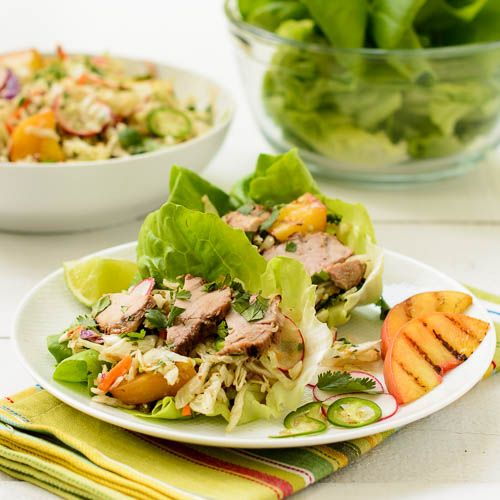 Asian Pork Lettuce Cups with grilled pork tenderloin, peaches, and Asian slaw. It's a festival of flavors and wonderful for a summer meal.