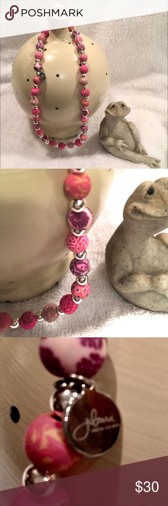 """Jilzara Handmade Beaded Pink Clay Necklace Jilzara 16"""" necklace on an elastic band. Each bead is unique and handmade. Different tones and patterns of pink with silver tone smaller beads in between. It has the small 'Jilzara' charm. Perfect for spring and summer. jilzara Jewelry Necklaces"""