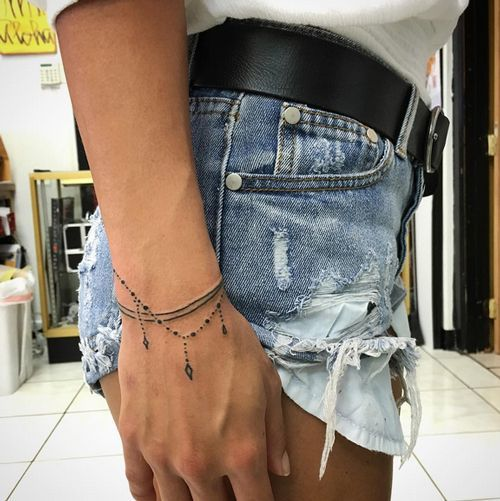 17 best ideas about wrist bracelet tattoos on pinterest for Delicate wrist tattoo designs