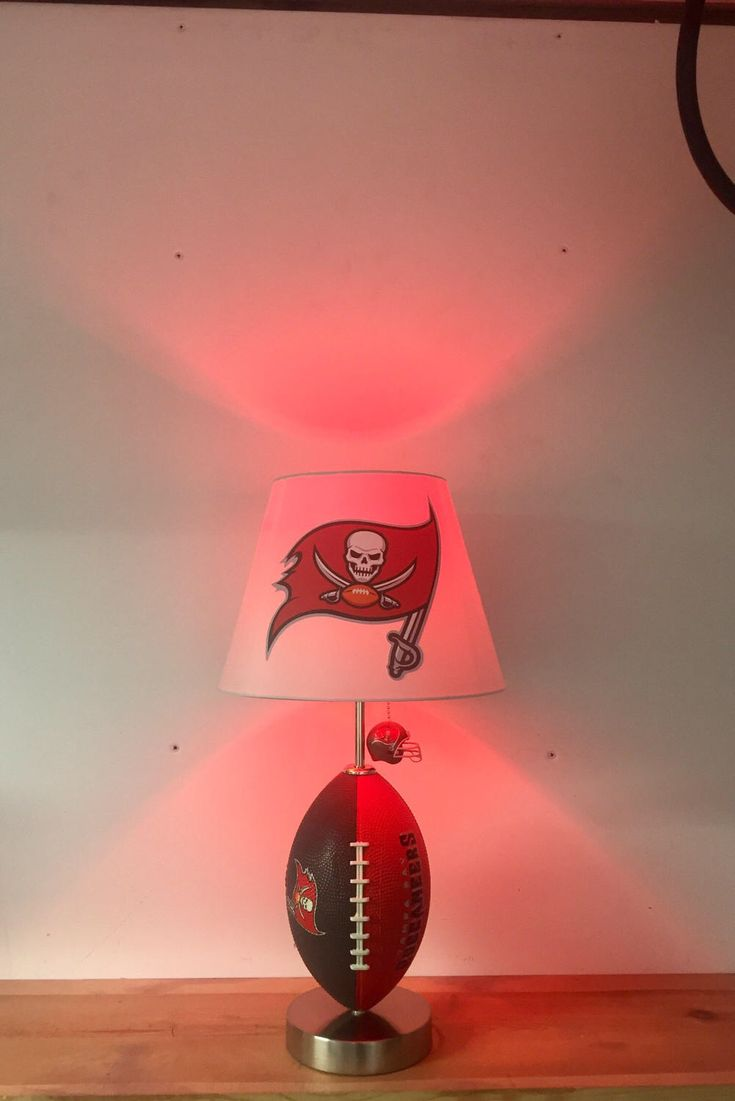 NFL, Tampa Bay Buccaneers Football Lamp, man cave, sports lamp, kids night light, table lamp, Buccaneers by CaliradoArt on Etsy https://www.etsy.com/listing/520639119/nfl-tampa-bay-buccaneers-football-lamp