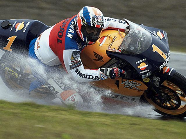 Mick Doohan His record of 12 wins in GP Class in a single season was tied by Marc Marquez at Malaysian GP.