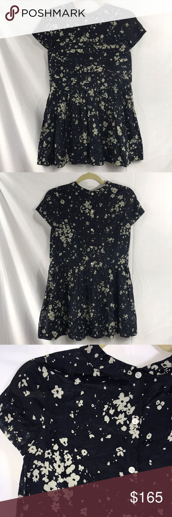 Burberry Paint Splatter Shirt Dress NEW WITH TAGS. 100% AUTHENTIC.   - Color: Navy/Beige - Mini Round Collar Design  - Splater Paint Print  - Dolman Cap Sleeves  - Back Button up  - Pleated flared skirt - Top: Horizontal Pleated Design - Lined  - Principal Material: 69% Cotton & 31 Silk  - Lining: 100% Cotton Burberry Dresses Casual