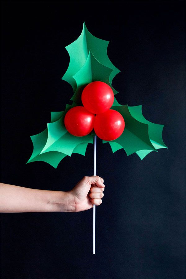DIY Holly Balloon Sticks - fun Christmas decoration and a great photo prop!                                                                                                                                                                                 More