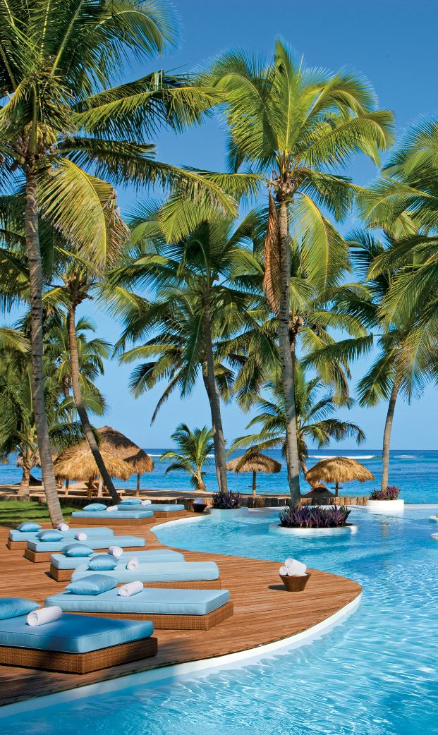 Bliss out from a cane-thatched suite on a white-sand beach at this exclusive escape. #PuntaCana