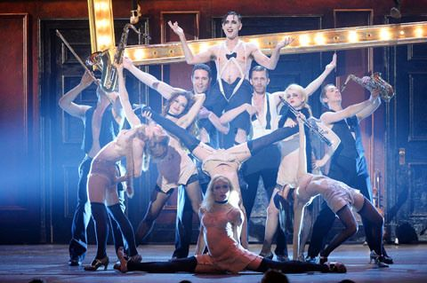 Alan Cumming, seen here with the Cabaret cast, dazzled during the show.