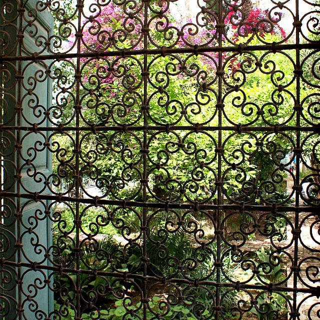 This wrought iron grate provides glimpses of the paradise enclosed within at the Palais Bahia in Marrakech.