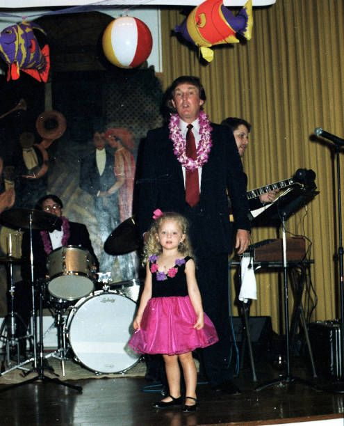 American real estate developer Donald Trump and his daughter Tiffany stand on stage at the MaraLago estate Palm Beach Florida March 1 1997 The...