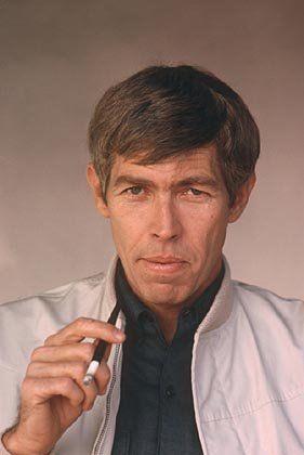 James Coburn.  He was cool like Bond.