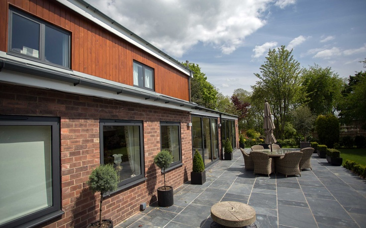 House Remodel. Timber cladding, zinc roof, bi-folding doors, patio, landscape garden