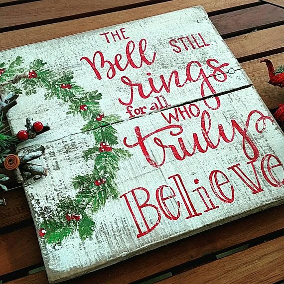The bell still signs for all who truly believe.  This cute Christmas sign has the quote taken from The Polar Express. Measuring approximately 12x12 this sign is painted in white and has hand lettered red font. A hand painted wreath adorns the side. It is then distressed and