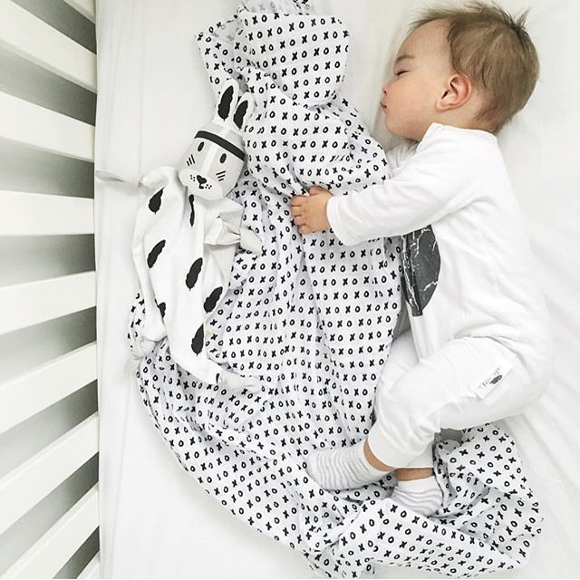 Dreaming away with Modern Burlap's XO swaddle blanket.