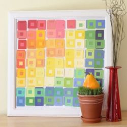 Layer square cut-out paint chips to make a textured art piece.
