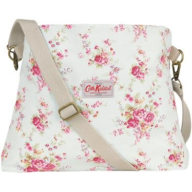 Our new fold over cotton messenger bag is spacious and stylish, with more than enough room for all your daily essentials. This pretty Washed Roses design has an adjustable, striped webbing strap, and contrasting Hampton Rose lining.