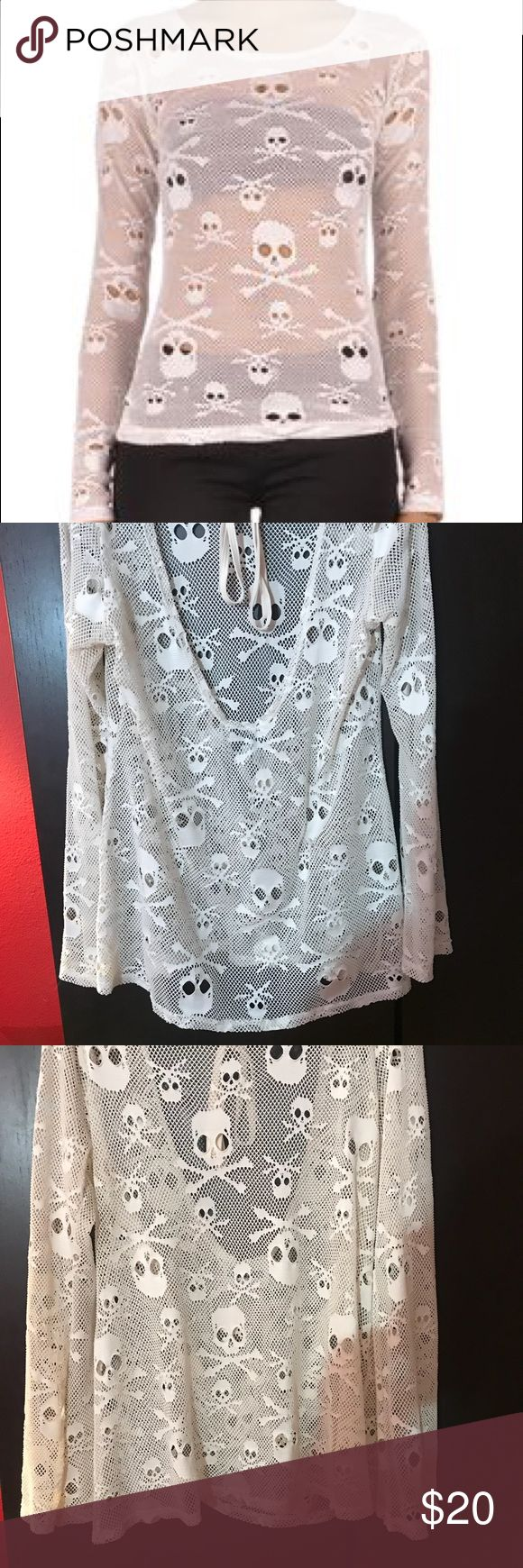 Royal Bones white fishnet skull tie back top Really cool fishnet too with long sleeves, a scoop back with a tie, and skulls all over. The white is more like a cream or an ivory white- not a Snow White. Shirt is in good condition, the fishnet is all intact no snags. Royal Bones Tops Tees - Long Sleeve