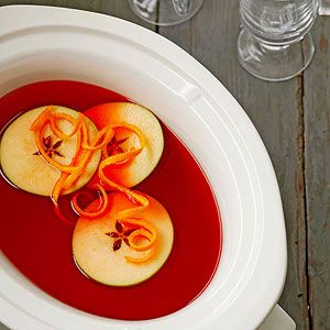 For a fun take on hot apple cider, add red cinnamon candies and fresh slices of red and green apples.