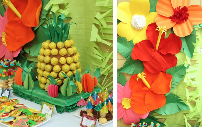 Hawaiian Luau dessert table:  Giant pineapple centerpiece was created by covering Styrofoam with fondant and attaching cake pops with toothpicks!  I also love the 3D fruit shapes made out of paper.