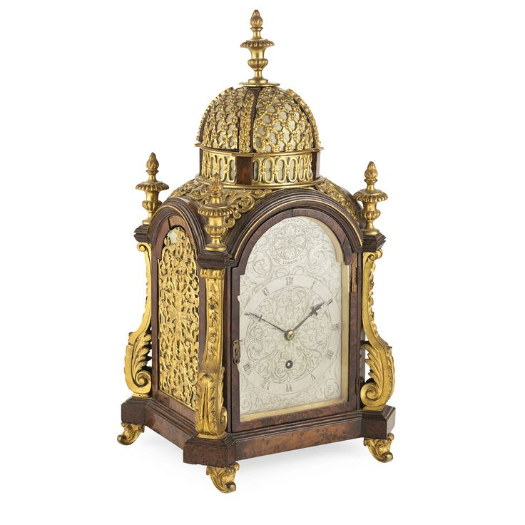 GEORGE III YEW WOOD AND GILT BRONZE MOUNTED TABLE CLOCK 18TH CENTURY, THE MOVEMENT 19TH CENTURY the cupola top with an urn finial and set with pierced lattice panels above a domed case with urn finials above canted corners, with foliate cast scroll mounts, the back and side panels with pierced foliate gilt metal frets, the later arched silvered dial engraved with foliate scrolls and Roman numbers and inscribed 'RENNER / LONDON', with one winding hole; the backplate signed 'J.F. Renner…