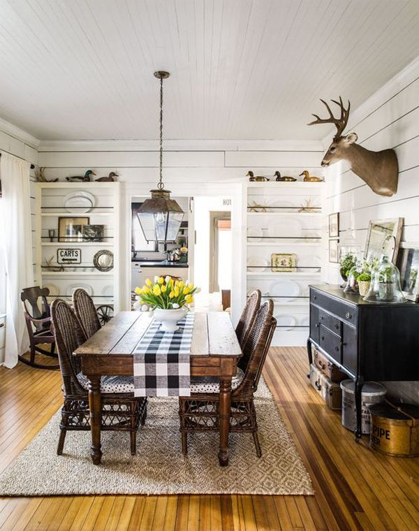 I really can't bear deer heads, and this lovely dining room would not suffer the least, its loss. So zero it out, and focus on the lovely detailed buffet, built-in shelves and generous farmhouse table. The black and white buffalo check runner pulls everything together.
