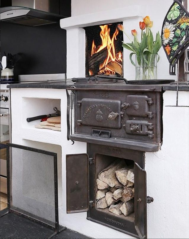 Husqvarna 228 cooking range / vedspis with open fireplace in Swedish kitchen