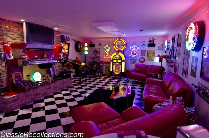 wow! So I don't love every little detail about this, but I think the 50's theme for a basement entertainment room would be so cool!