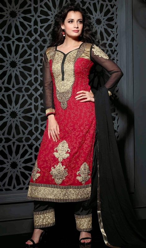 Surround yourself with endless compliments as Dia Mirza with this red embroidered chiffon and georgette salwar suit. The extravagant lace and resham works make it an absolute flattering piece. #LovelyRedAndBlackEmbroideredPantStyleDiaMirzaDress