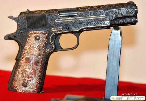 1911 Colt .45 beautifully engraved