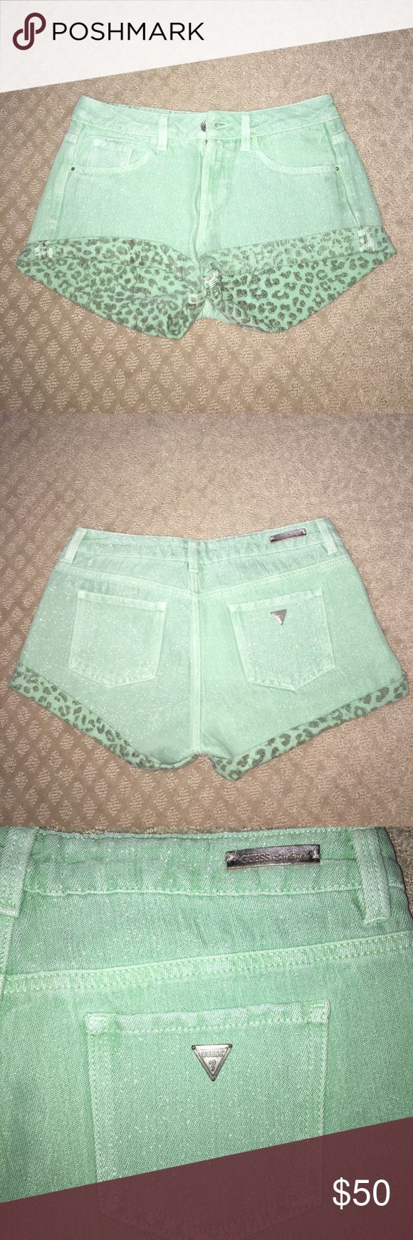 Guess mint green denim mid waisted shorts Guess mid rise denim shorts. Mint green with silver/Sparkly thread. Inside shorts is a cheetah print and the bottoms roll up giving a cheetah trim. Closes with button and zipper and is a size 26. Worn once Guess Shorts Jean Shorts