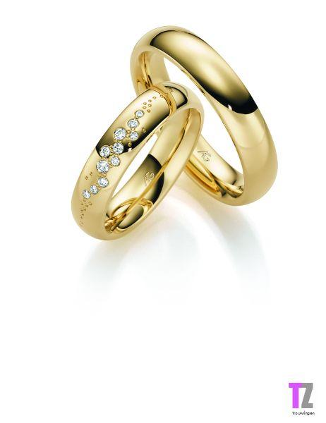 Geelgouden trouwringen met diamant voor de dame. Kijk voor meer trouwringen op www.trouwringen-zwolle.nl