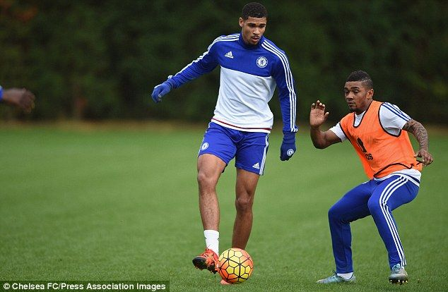 Chelsea midfielder Ruben Loftus-Cheek protects the ball from the attention of Reece Mitchell