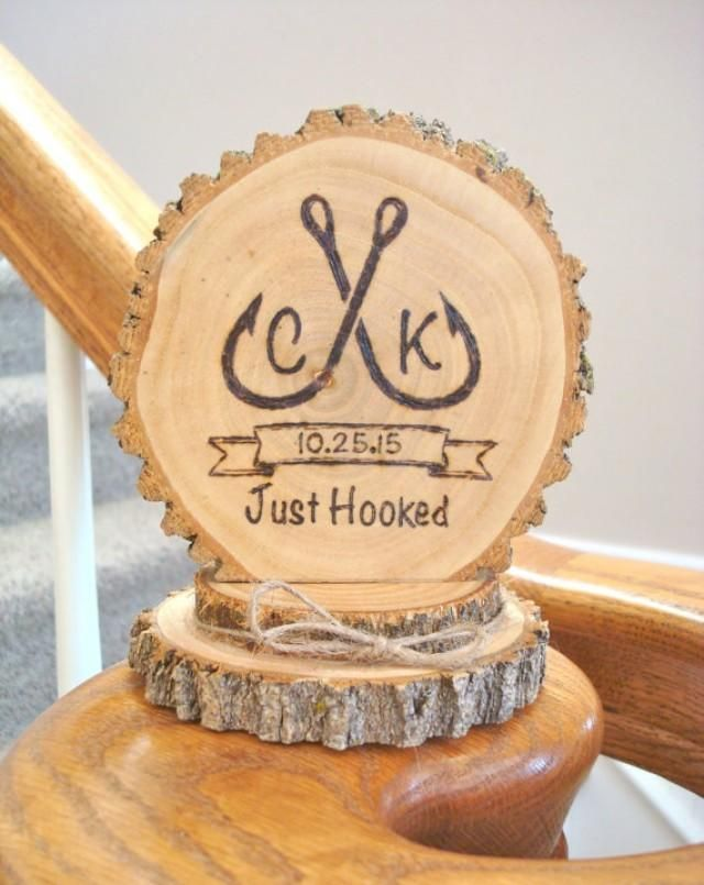 Rustic wood wedding cake topper Made from wood slices Wood burned fisherman hooks Personalized with your initials and date Twine bow Size: