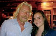 Young entrepreneurs turn a Tweet from Richard Branson into $1 Million. Photo of Stacey Ferreira and Richard Branson.