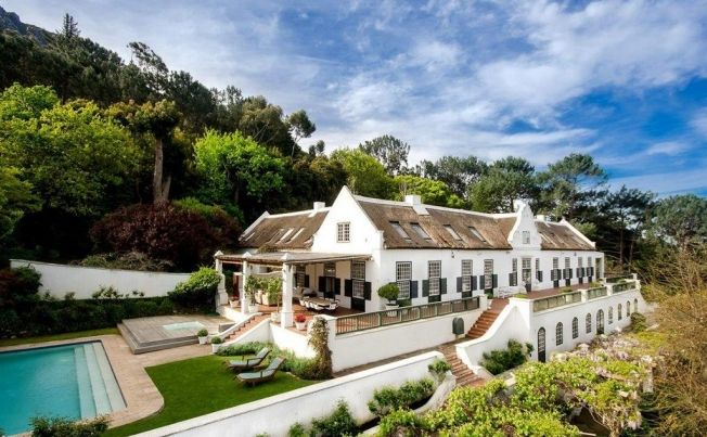 Set among woodlands just at the base of the Constantia Nek hiking trail, this extraordinary property commands the most breathtaking views of the Constantia valley, vineyards and False Bay.   To view more beautiful properties like this one, visit the 9 PROVINCE property portal for South Africa at https://nineprovince.co.za/